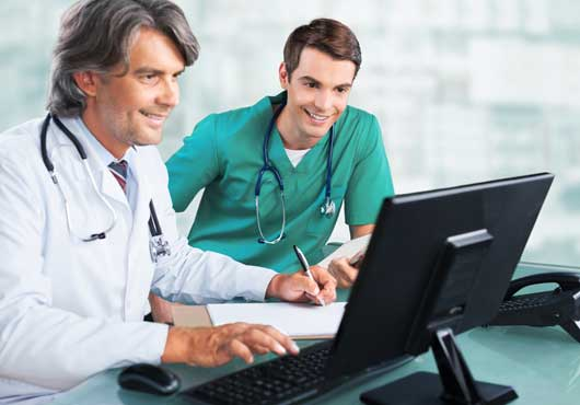 Two specialists reviewing the results of a customer