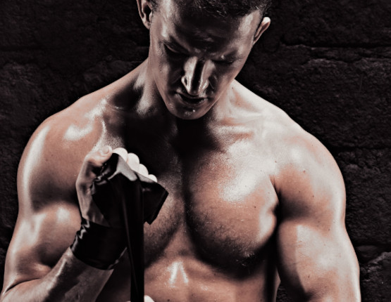 Muscular athlete performing strength movement
